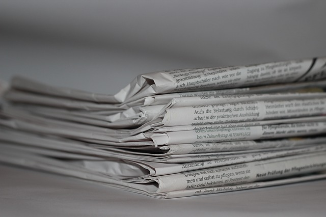 Newspapers for lining parrot cages